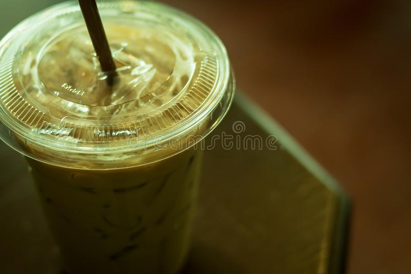 Ice coffee latte. In plastic cup on top table, color vintage style, selective focus stock photography