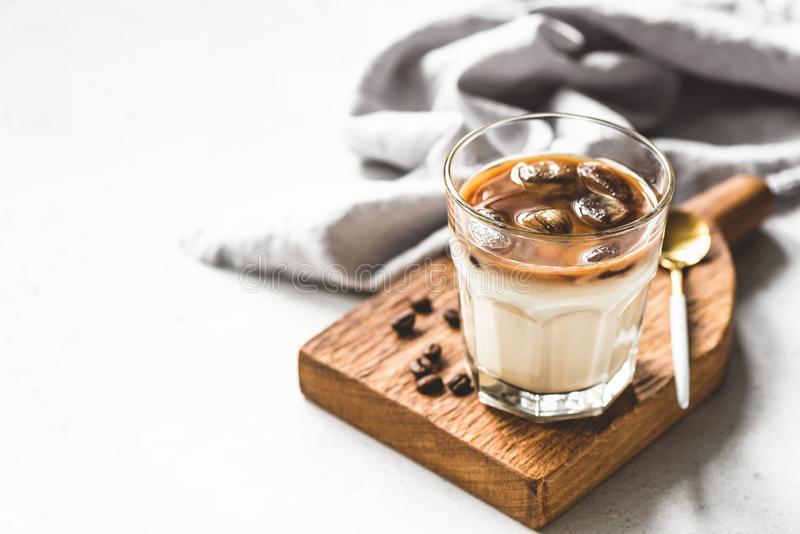 Ice coffee latte in glass. Ice coffee latte, refreshing and energy boost cold drink in glass. Copy space for text royalty free stock photo