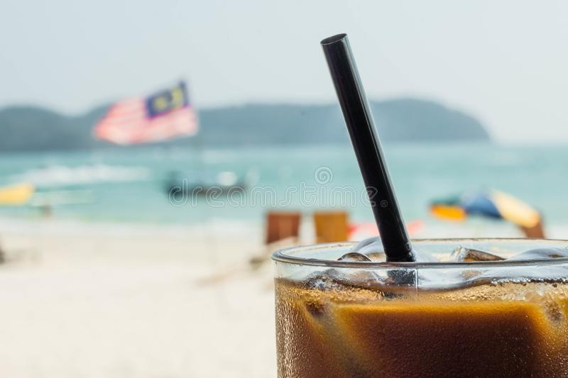 Ice coffee with a malaysian flag on the background. Enjoying holidays concept stock photo