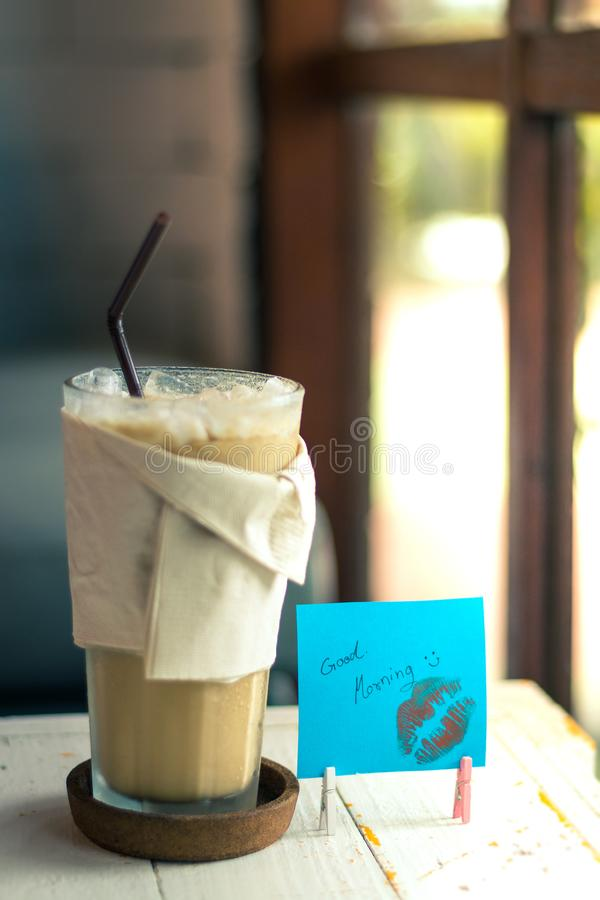 Ice coffee and paper note with good morning. Paper note blue color royalty free stock image