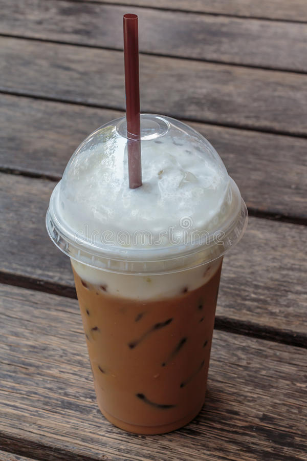 Ice coffee. In plastic cup royalty free stock images