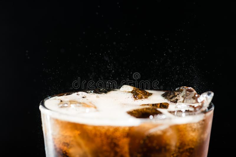Ice cola with splashing CO bubbles in a glass stock photos