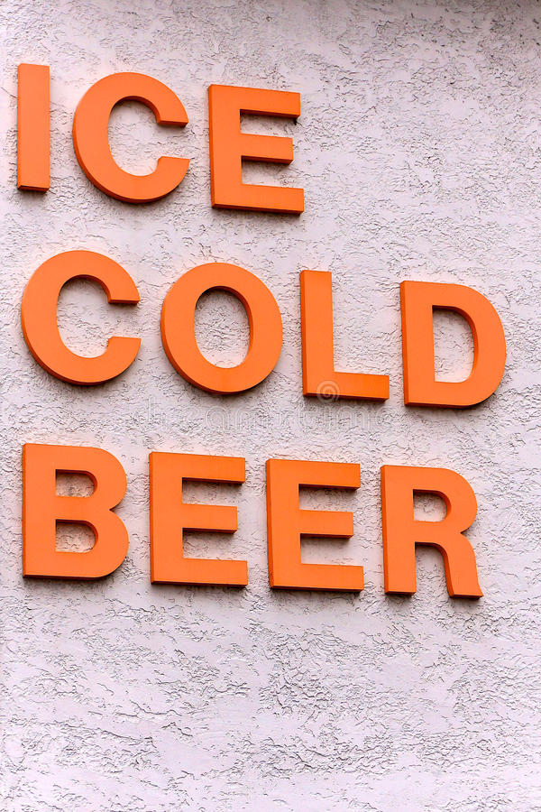 Ice Cold Beer Sign. Ice cold beer spelled out in bold orange block letters royalty free stock photos