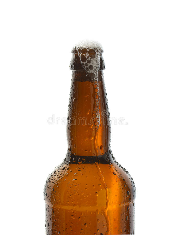 Ice cold bottle of beer. Ice cold open bottle of refreshing beer royalty free stock image