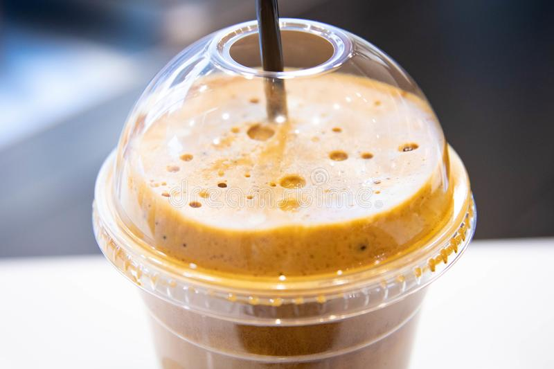 Ice cold coffee froth in a plastic cup stock images