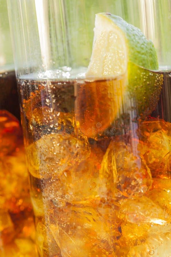 Ice cold summer drinks in sunlight garden. Ice cold summer in sunlight outdoors royalty free stock image