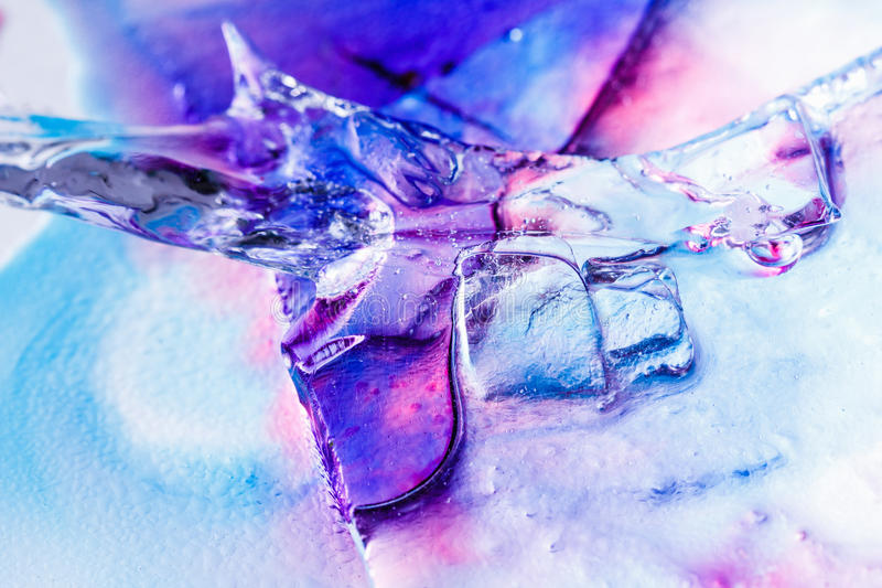 Ice colorful, multicolor texture background with ink. Ice texture background, ink in water pattern frost. Crystal winter colorful, multicolor design stock photography