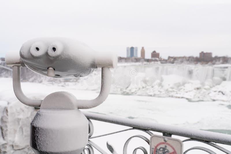 Binoculars looking at Niagara Falls in winter stock image