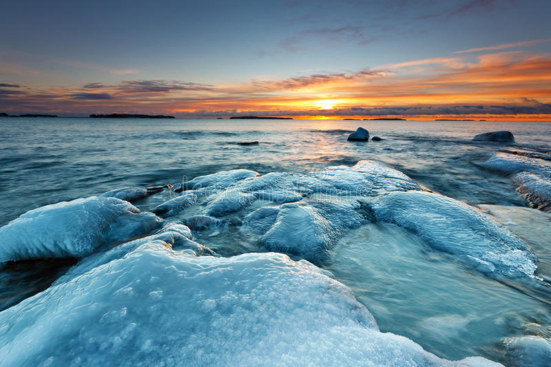 Ice covered rocks royalty free stock photo