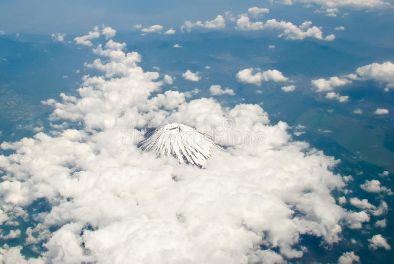 Ice covered volcano crater taken fron and airplane during my flight from Japan to Manila. Not sure if it Mt. Fuji.  stock image