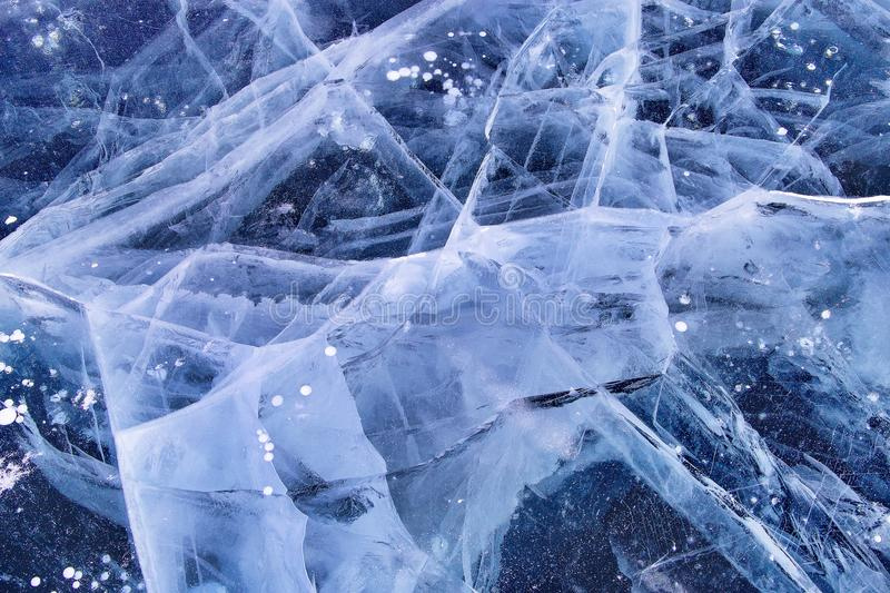 Ice and cracks on the surface of Lake Baikal. Winter time royalty free stock photography