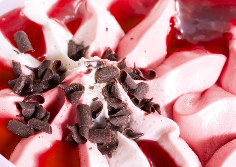 Ice cream. Ice-cream with a cherry syrup and a chocolate crumb stock images