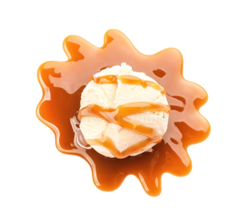 Ice cream ball with caramel sauce. On white background royalty free stock image