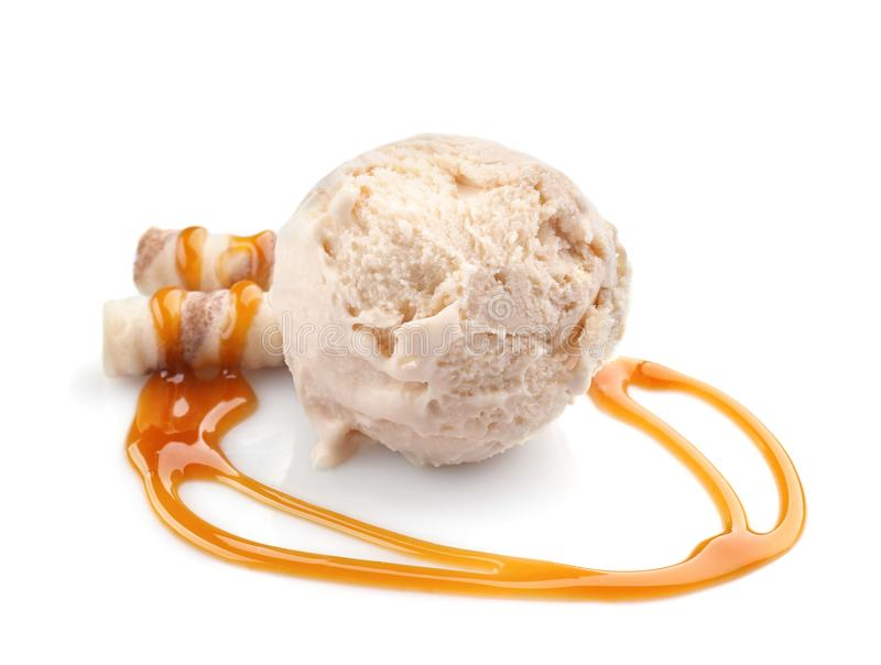 Ice cream ball with wafer sticks and caramel sauce. On white background royalty free stock photo