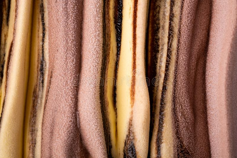 Ice cream banana chocolate cream texture, pattern, surface, cold milk dessert, summer, top view. Close up macro royalty free stock photo