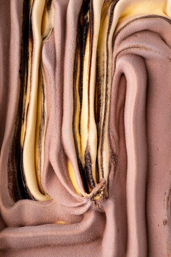 Ice cream banana chocolate cream texture, pattern, surface, cold milk dessert, summer, top view. Close up macro stock photography