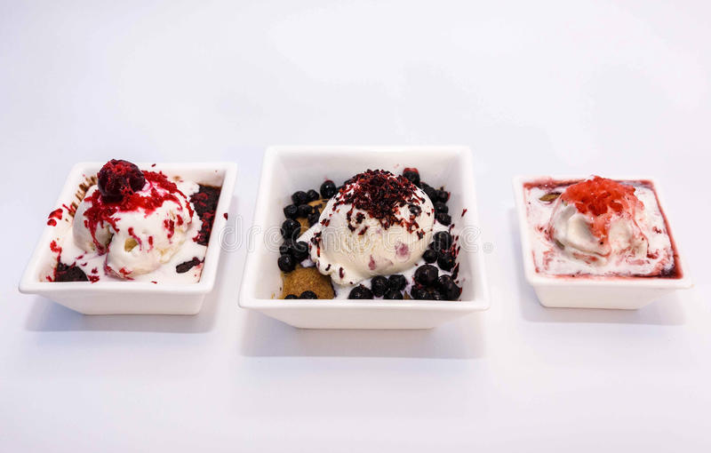 Ice cream with berry stuffing, cream, strawberries, blueberries and cookies with chocolate royalty free stock image