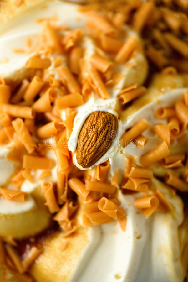 Ice cream with caramel sauce and almond. Summer food concept, copy space, top view. Scooped texture.  royalty free stock photography