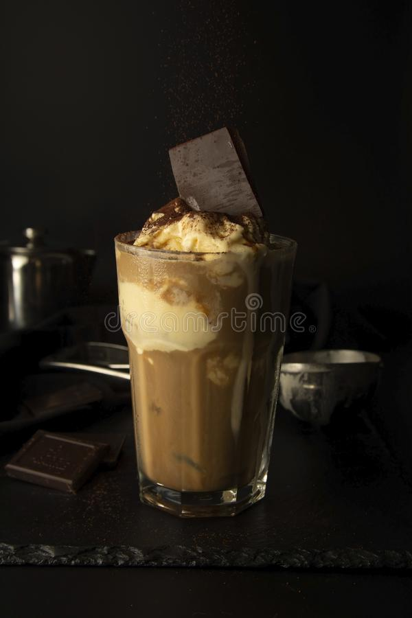Ice-cream and coffee cocktail in glass. summer, refreshing coffee drink over black background. Ice cream and coffee cocktail in glass. summer, refreshing coffee royalty free stock images