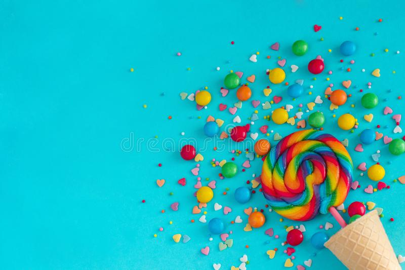 Ice cream cone with colorful lollipop and multicolored sweets, g royalty free stock photos