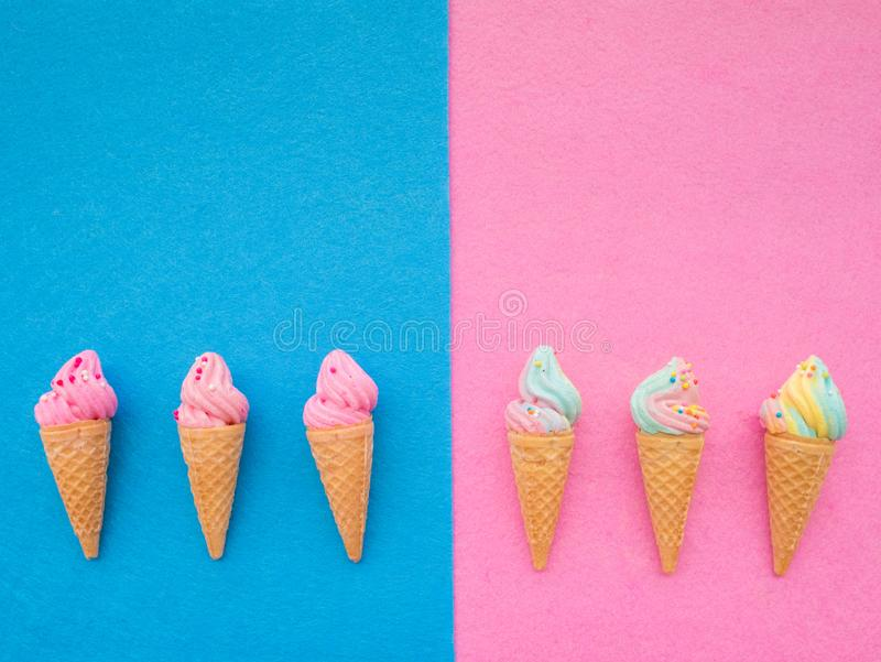 Ice cream in the cone colorful set on blue and pink background royalty free stock images