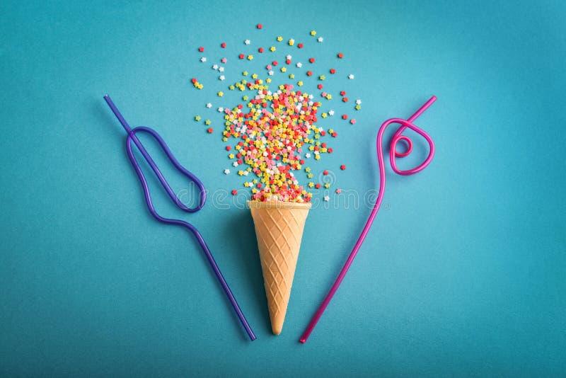 Ice cream cone with colorful stars confetti stock photo