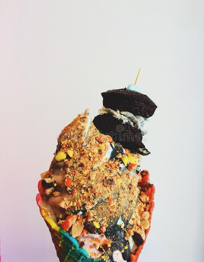 Ice Cream on Cone With Crushed Peanuts and Brownies royalty free stock photos