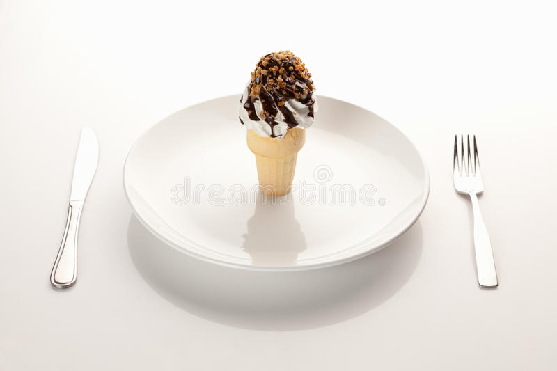 Ice cream cone on a place setting