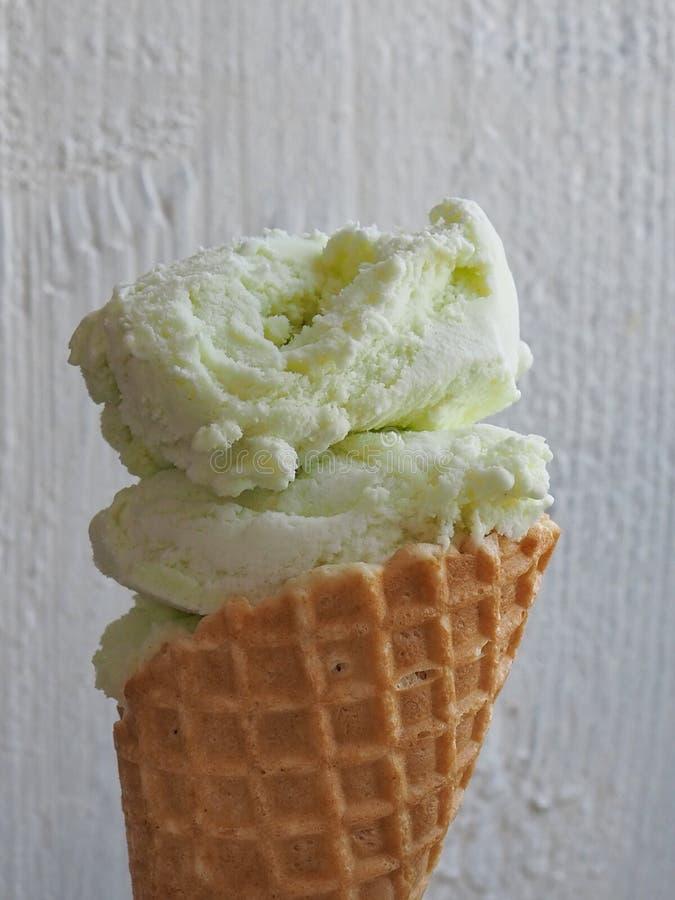Ice cream cone on white wooden background stock photos