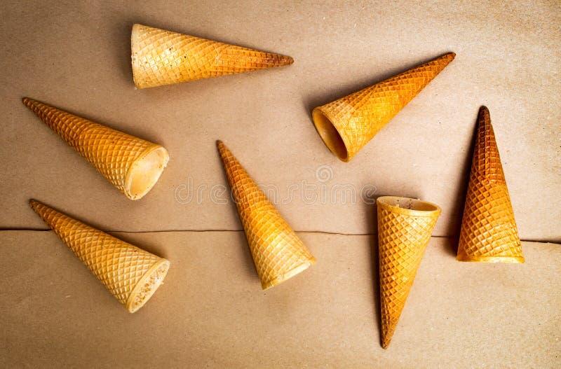 Ice cream cones against beige background. Empty ice cream cones against beige background stock photos