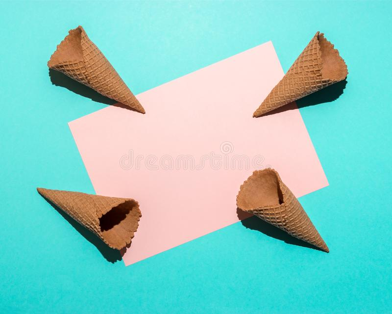 Ice cream cones on bright blue background. Minimal summer composition. Flat lay royalty free stock photos