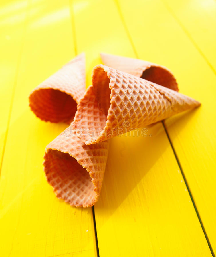 Ice cream cones on yellow table royalty free stock images