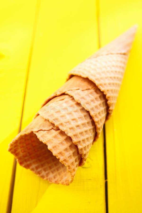 Ice Cream Cones On Yellow Table Royalty Free Stock Photo