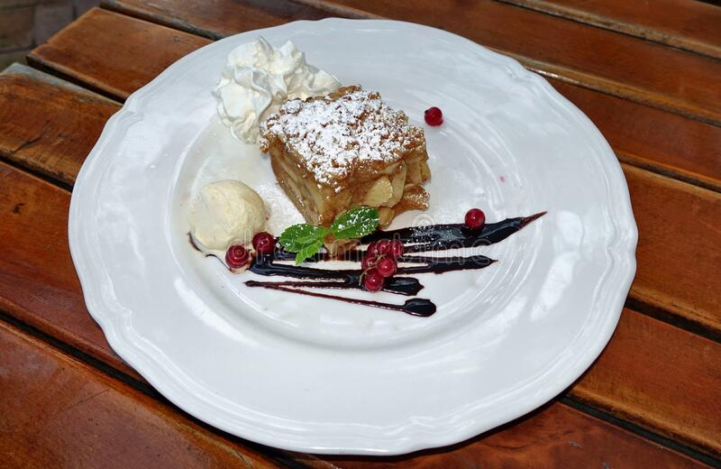 Ice cream currant apple pie on the plate. An Ice cream currant apple pie on the plate, Zabki, Poland royalty free stock photo