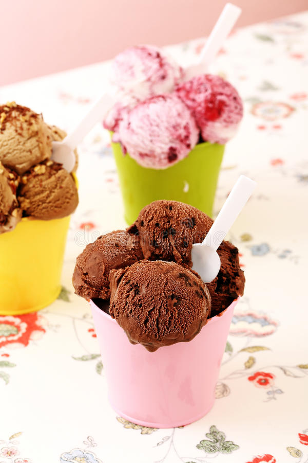Ice cream. Delicious caramel,berry and chocolate icecream in metal cup royalty free stock photo