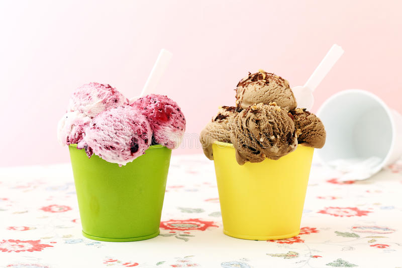 Ice cream. Delicious strawberry and caramel icecream in metal cup stock photo
