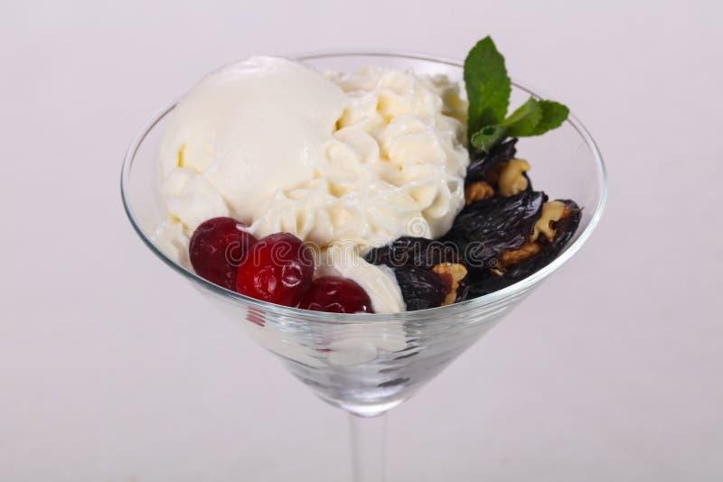 Ice cream with dry plum stock images