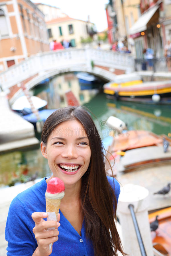 Ice cream eating woman in Venice, Italy royalty free stock photo