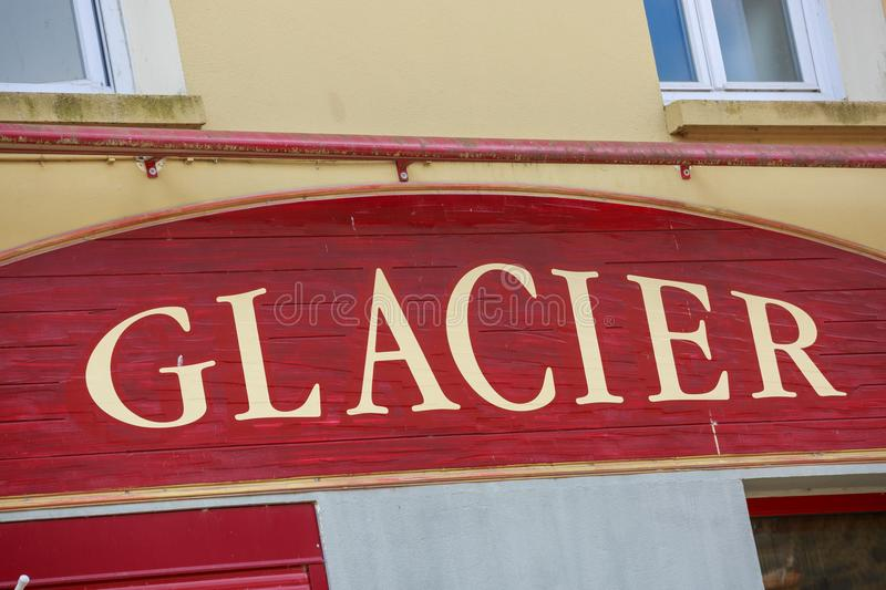 Ice Cream front store restaurant sign (Glacier in French). With Retro Style Facade stock image