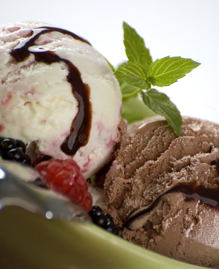 Ice cream and fruit. Fruit and chocolate ice cream with mint stock image