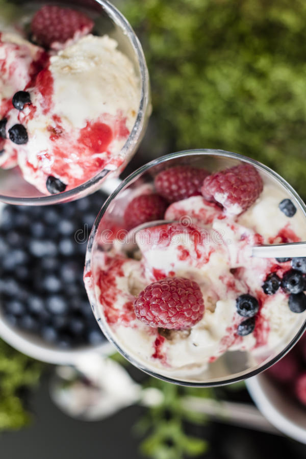 Ice cream with fruits raspberries, blueberries and with raspberries syrup stock photography