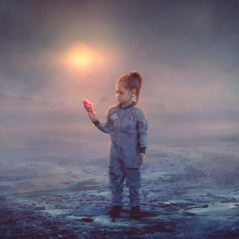 Ice cream melting on hot planet. A child holds a melting ice cream cone as she visits a very hot planet stock photos