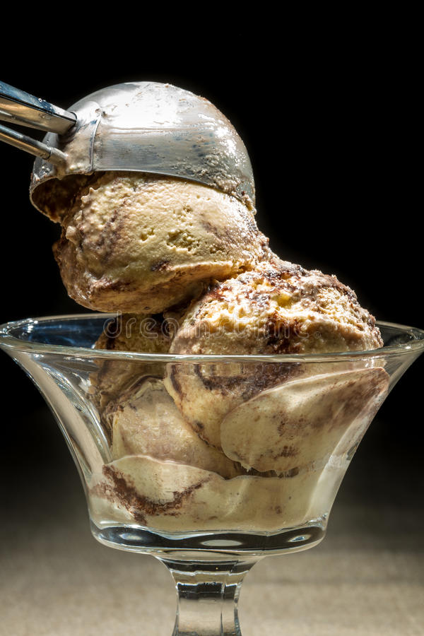 Ice cream with metallic spoon stock images