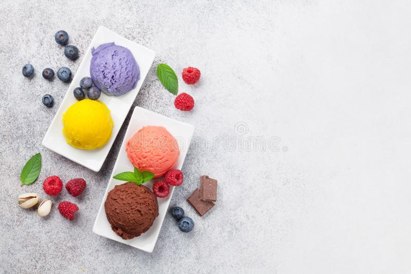 Ice cream with nuts and berries. Top view with space for your text stock photo