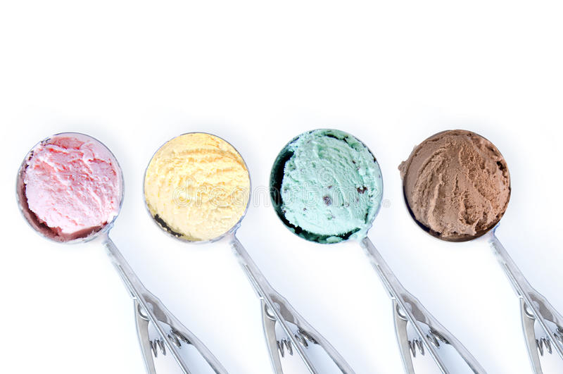 Ice cream scoops. Close up of four flavored ice cream scoops over a white background stock images