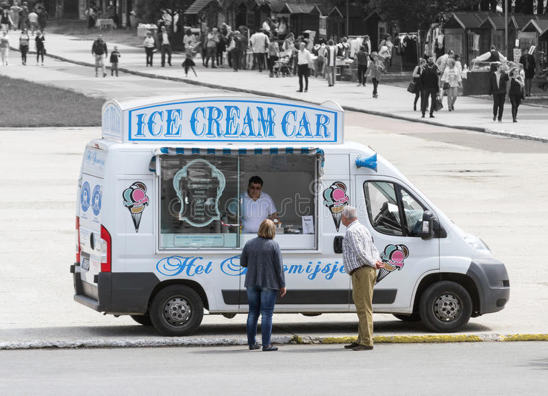 Ice cream seller. Serving customers from his musical ice cream traveling van stock photos