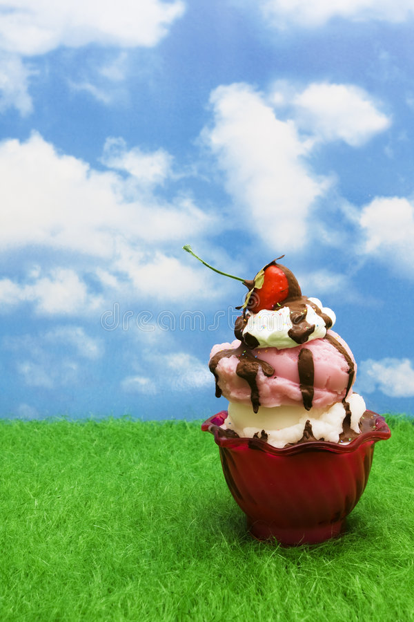 Ice-cream Sundae. On grass with copy space stock photography