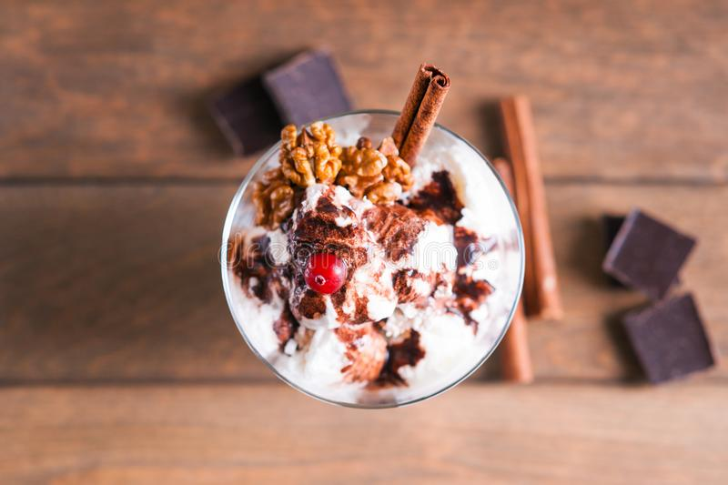 Ice cream sundae, spices and chocolate pieces royalty free stock image