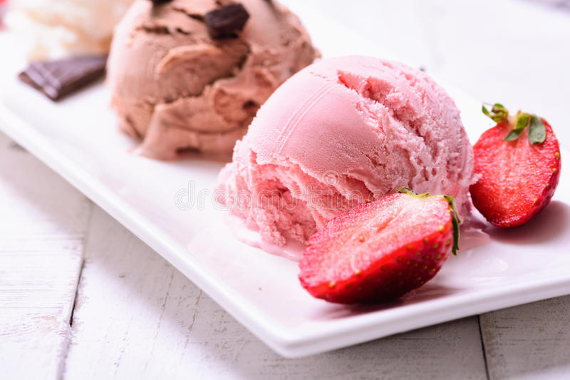 Ice cream. Three scoops of ice cream ( chocolate , vanilla , strawberry royalty free stock image