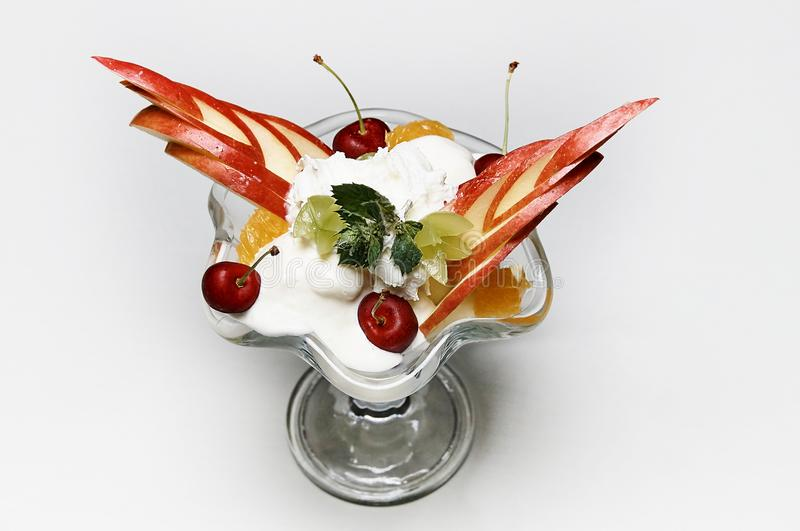 Ice cream with various fresh fruits. In a glass goblet stock photography